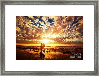 Surfer Standing With His Surfboard On The Beach At Sunset Over The Ocean Framed Print by Michal Bednarek