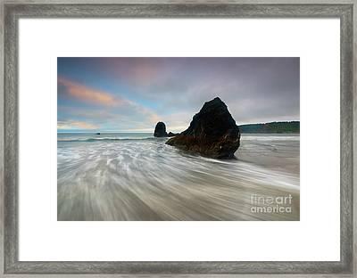 Swept Ashore Framed Print by Mike Dawson