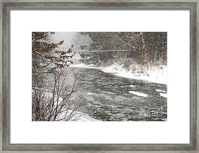 Swinging Bridge In Snow Storm Framed Print