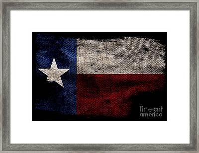 Tattered Lone Star Flag On Black Framed Print by Jon Neidert