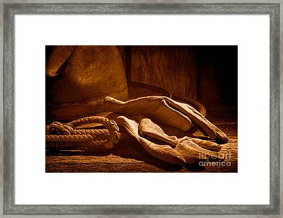 The Cowboy Gloves - Sepia Framed Print by Olivier Le Queinec