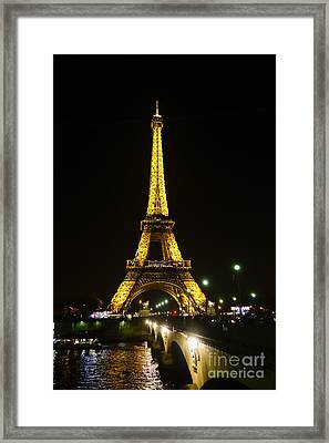The Eiffel Tower At Night Illuminated, Paris, France. Framed Print by Perry Van Munster