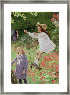 The Swing Framed Print by Percy Tarrant
