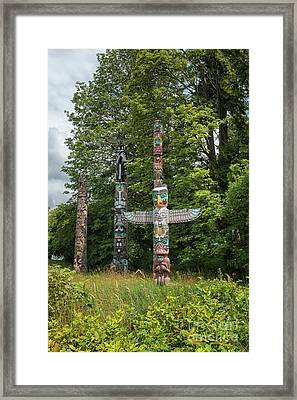 Totem Poles In Vancouver, Canada Framed Print by Patricia Hofmeester
