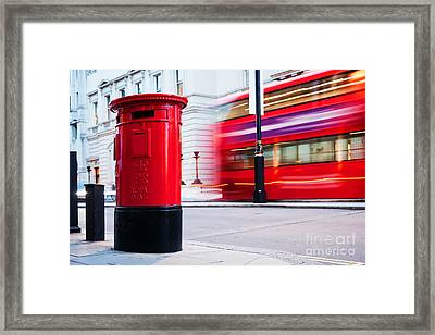 Traditional Red Mail Letter Box And Red Bus In Motion In London, The Uk Framed Print by Michal Bednarek