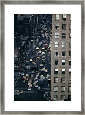 Traffic In New York City. View Framed Print by Everett