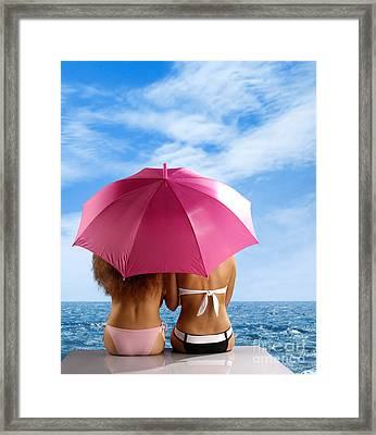 Two Women Relaxing On A Shore Framed Print by Oleksiy Maksymenko