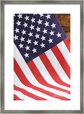 Usa Stars And Stripes Flag On Dark Wood Framed Print by Milleflore Images