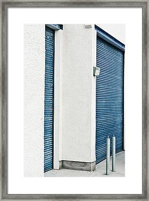 Warehouse Doors Framed Print by Tom Gowanlock