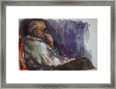 Man Watching Tv  Framed Print by Ylli Haruni
