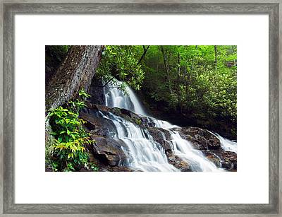 Water Cascading Over Rocky Cliffs Framed Print by Panoramic Images