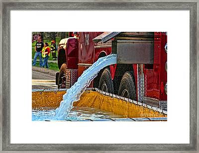 Water Dump Framed Print by Tommy Anderson