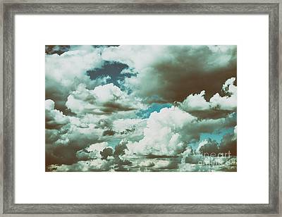 White Cumulus Clouds And Grey Storm Clouds Gathering On Blue Sky Framed Print by Radu Bercan
