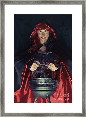 Witch And Her Cauldron Framed Print by Amanda Elwell