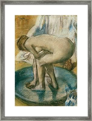 Woman Bathing In A Shallow Tub Framed Print by Edgar Degas