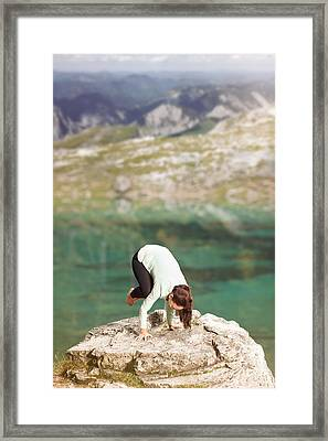 Woman Doing Yoga On A Rock On The Lake Shore Framed Print by Wolfgang Steiner