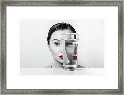Woman Face Distortion In Glass Of Water Framed Print by Radu Bercan