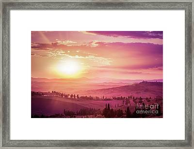 Wonderful Tuscany Landscape With Cypress Trees, Farms And Medieval Towns, Italy. Pink And Purple Sunset Framed Print