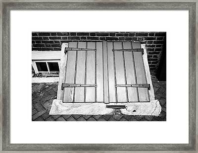 wooden door access to basement in elfreths alley in the old city of Philadelphia USA Framed Print
