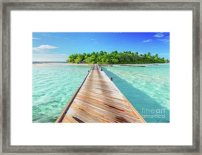 Wooden Jetty Towards A Small Island In Maldives Framed Print