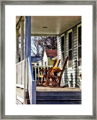 Wooden Rocking Chairs On Porch Framed Print by Susan Savad