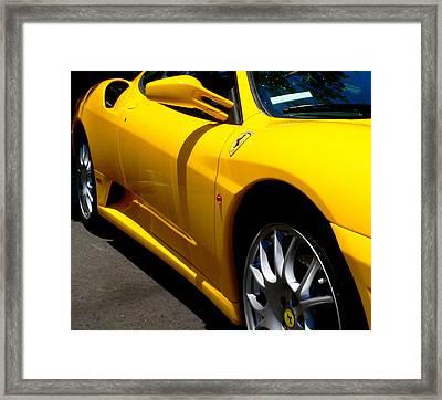Yellow Ferrari Framed Print by Jeff Lowe