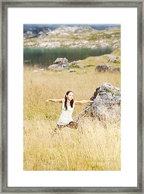 Yoga Poses In High Grass In Front Of A Mountain Lake In The Alps Framed Print by Wolfgang Steiner