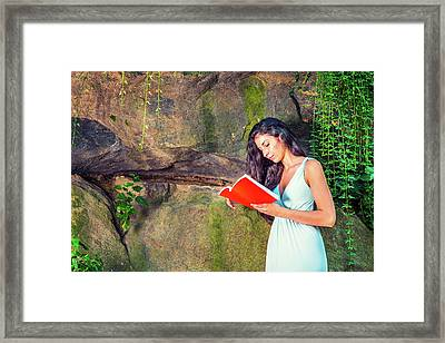Young American Woman Reading Book At Central Park, New York, In  Framed Print