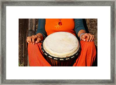 Young Lady Drummer With Her Djembe Drum On Rustic Wooden Door Background. Framed Print by Jozef Klopacka