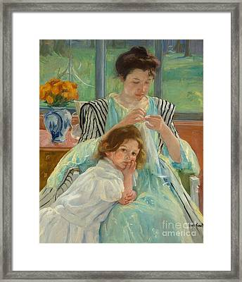Young Mother Sewing Framed Print