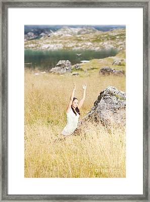 Young Woman Doing Yoga Exercises In High Grass Framed Print by Wolfgang Steiner