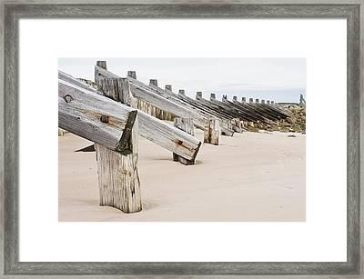 Breakwater Framed Print by Tom Gowanlock