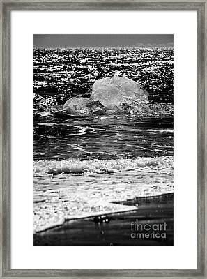 Iceberg Washing Up On Black Sand Beach At Jokulsarlon Iceland Framed Print