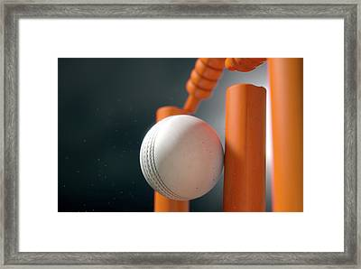 Cricket Ball Hitting Wickets Framed Print