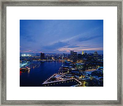 High Angle View Of A City Lit Framed Print by Panoramic Images