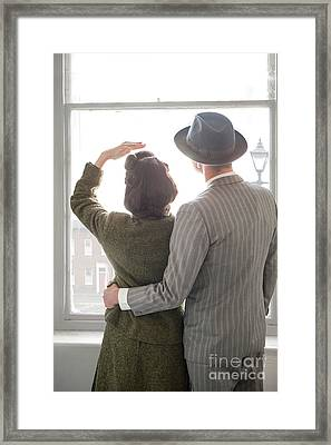 1940s Couple At The Window Framed Print