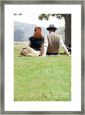Framed Print featuring the photograph 1940s Couple Sitting In The Sunshine by Lee Avison