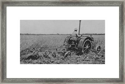 A Farmer Driving A Tractor Framed Print by American School