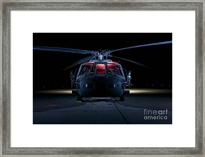 A Uh-60 Black Hawk Helicopter Lit Framed Print by Terry Moore