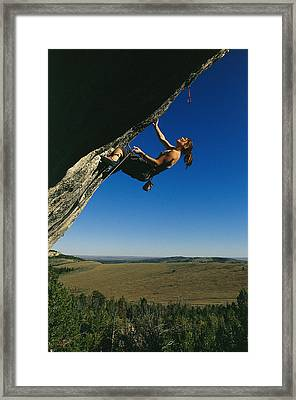 A Young Woman Climbing The Rock Feature Framed Print by Bobby Model