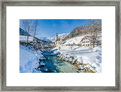 Alpine Winter Beauty With Snowy Church And River Framed Print