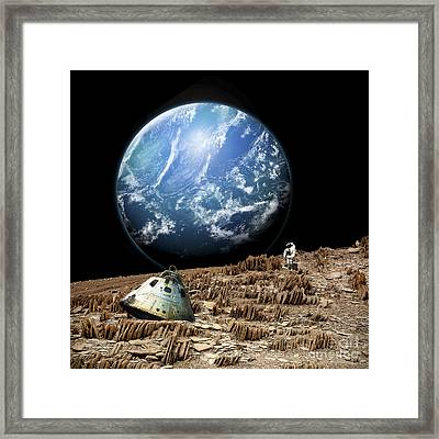 An Astronaut Surveys His Situation Framed Print by Marc Ward