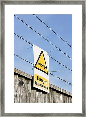 Barbed Wire Fence Framed Print by Tom Gowanlock