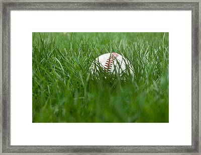 Baseball In Grass Framed Print