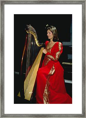 Beautiful Harp Player Framed Print by Carl Purcell