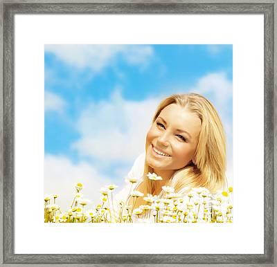Beautiful Woman Enjoying Daisy Field And Blue Sky Framed Print
