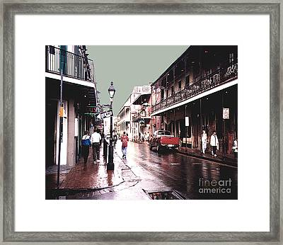 Bourbon Street After The Rain Framed Print by Merton Allen
