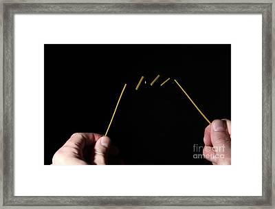 Breaking Spaghetti Framed Print by Ted Kinsman