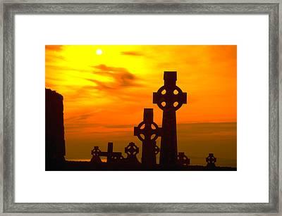 Celtic Crosses In Sunset Framed Print by Carl Purcell