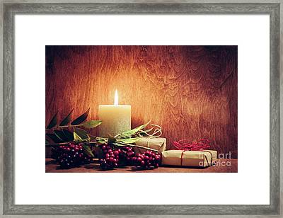 Chistmas Presents, Gifts With A Candle Glowing On Wooden Wall Background. Framed Print by Michal Bednarek